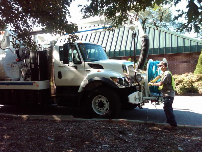 City Employee With Jet Vac Truck